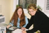 Student volunteer Natalie Lauzon at the Reception desk at the Apple Hill Clinic with Helene Chartrand.